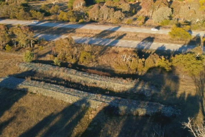 Large rubbish piles of Canberra glass 'should be shipped back to ACT'